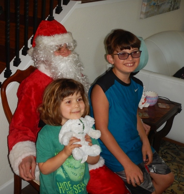 Minnie Siemer and Clive Baker sit on Santa's lap on Easter.