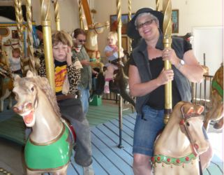 Janet Gray, Panch Baker, John Siemer and Kara Siemer on a carousel