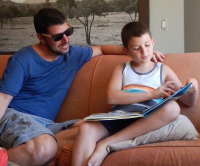 Clive Baker reads to Daddy Dan Baker on Father's Day