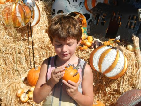 Clive Baker decorates a pumpkin.