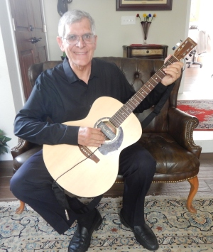 Michael Gray with his guitar.