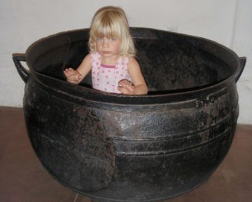 Kara Siemer in a cauldron at Mission San Jose.