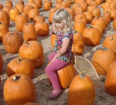 Kara Siemer at a pumpkin patch.