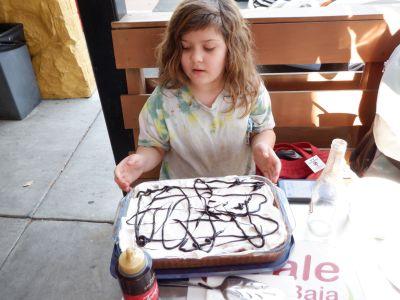 Minnie with her mom's birthday cake.