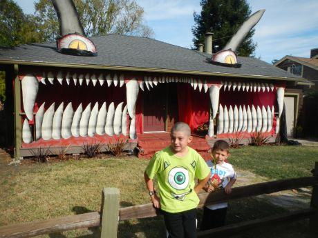 Kyan and Clive Baker in front of a neighbor's Monster House.