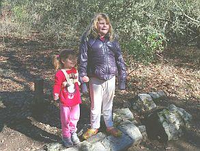 Kara and Minnie Siemer on a petrified log.